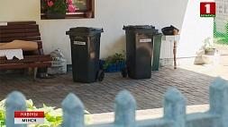 Владельцам частных домов в Минске начали выдавать бесплатные контейнеры для мусора Уладальнікам прыватных дамоў у Мінску пачалі выдаваць бясплатныя кантэйнеры для смецця