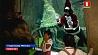 В Гвадалахаре биолог в костюме Санта-Клауса погрузилась в аквариум с рыбами У Гвадалахары біёлаг у касцюме Санта-Клауса апусцілася ў акварыум з рыбамі