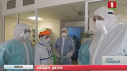 Спасатели в белых халатах. Репортаж с передовой Ратавальнікі ў белых халатах. Рэпартаж з перадавой